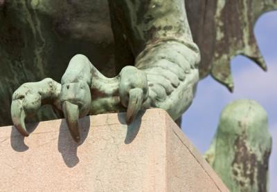 Ljubljana, Slovenia --- Ljubljana, Slovenia; claws on one of the green copper dragon statues on Zmajski (Dragon Bridge) --- Image by © Lizzie Shepherd/Design Pics/Corbis